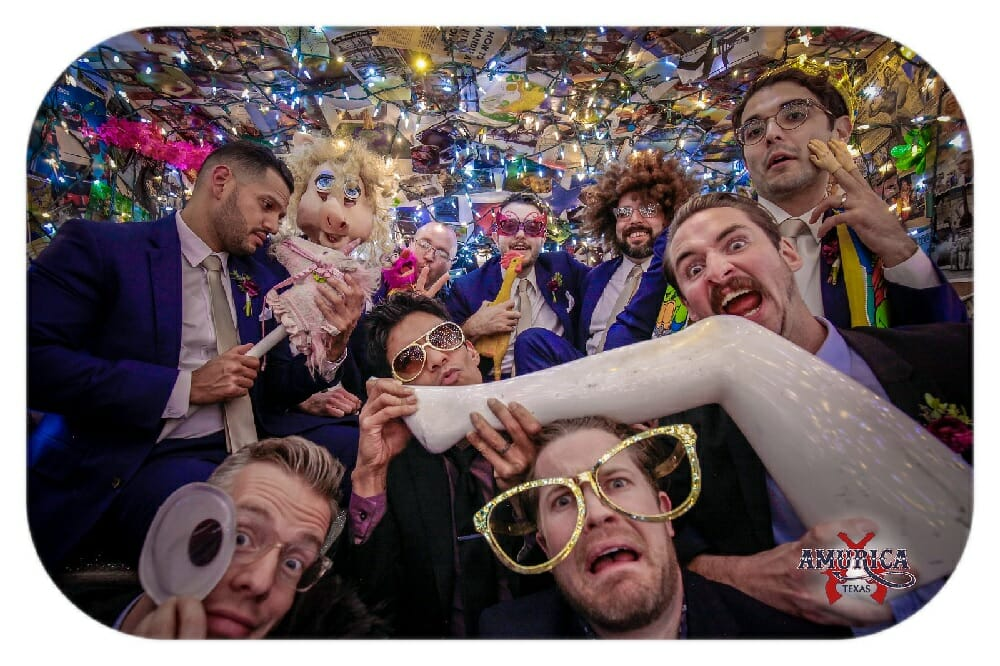 wedding photobooth rental example multiple men in suits acting silly